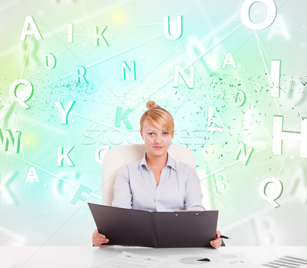 Business woman at desk with green word cloud Stock photo © ra2studio