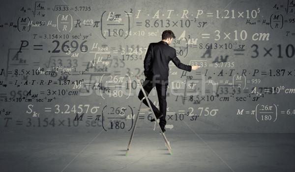 человека лестнице бизнесмен элегантный костюм Постоянный Сток-фото © ra2studio