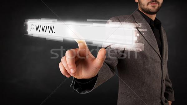 Fiatal üzletember megérint háló böngésző cím Stock fotó © ra2studio