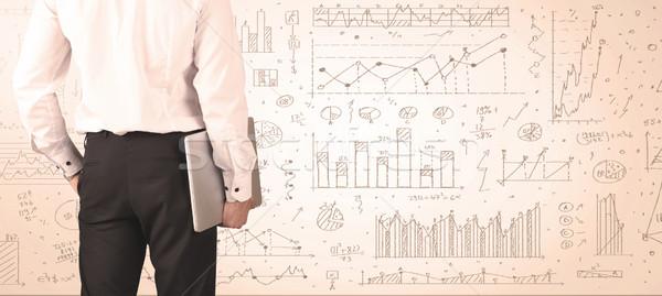 üzletember diagramok grafikonok hát pénzügy piac Stock fotó © ra2studio