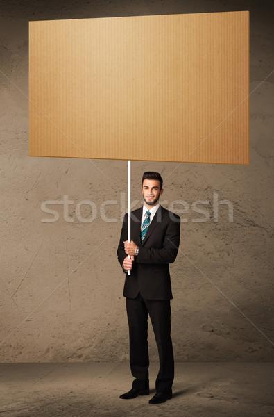 Zakenman karton jonge bruin business Stockfoto © ra2studio