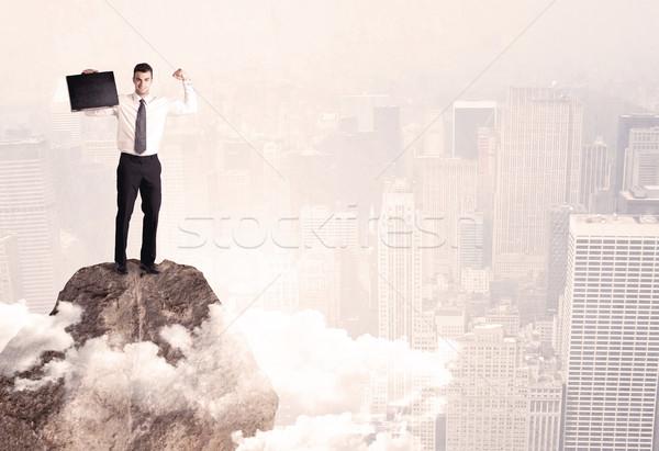 Mutlu işadamı ayakta taş üst zarif Stok fotoğraf © ra2studio