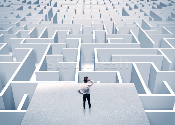 Businessman staring at infinite maze Stock photo © ra2studio