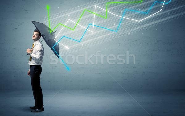 Foto stock: Empresário · guarda-chuva · mercado · de · ações · colorido · negócio