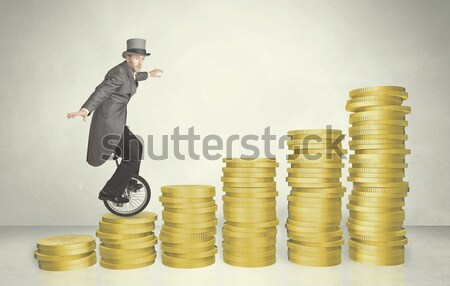 Business man riding monocycle up on coin graph Stock photo © ra2studio