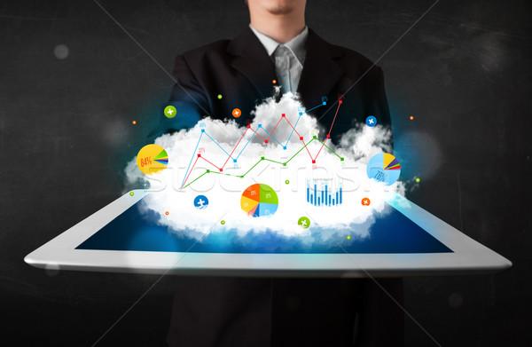 Személy tart touchpad felhő technológia táblázatok Stock fotó © ra2studio