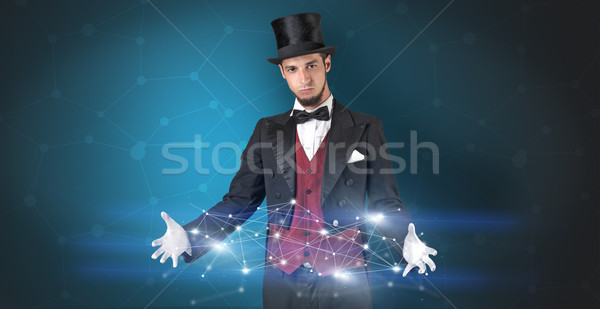 Magician with geometrical connection on his hand  Stock photo © ra2studio