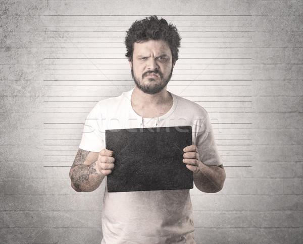 Gengszter börtön fal asztal kéz férfi Stock fotó © ra2studio