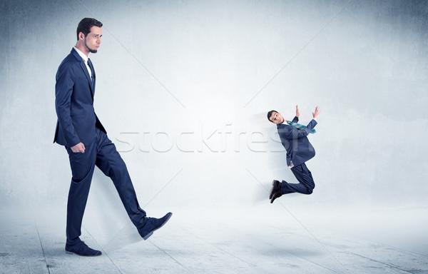 Duży biznesmen mały pływające z dala Zdjęcia stock © ra2studio