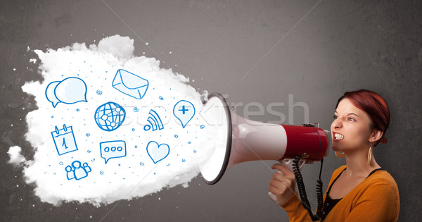 Young woman shouting into loudspeaker and modern blue icons and symbols come out Stock photo © ra2studio