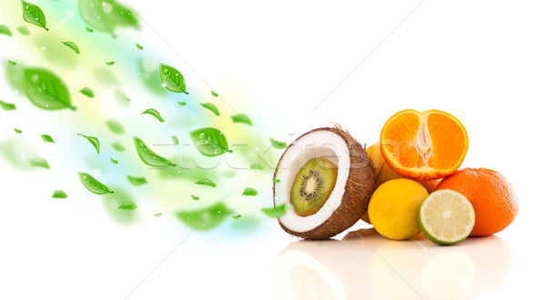 Colorful fruits with green organic leafs Stock photo © ra2studio
