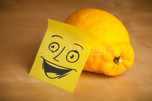 Post-it note with smiley face sticked on a lemon Stock photo © ra2studio