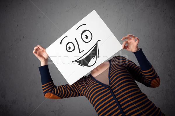 Nő tart karton mosolygós arc fiatal nő papír Stock fotó © ra2studio