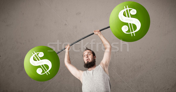 skinny guy lifting green dollar sign weights Stock photo © ra2studio