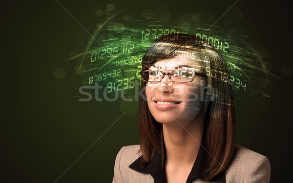 Business woman looking at high tech number calculations  Stock photo © ra2studio