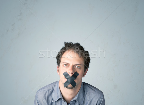Young man with glued mouth  Stock photo © ra2studio