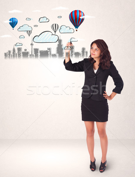 Pretty woman sketching cityscape with colorful balloons  Stock photo © ra2studio
