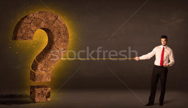 Iş adamı büyük katı soru işareti taş Stok fotoğraf © ra2studio