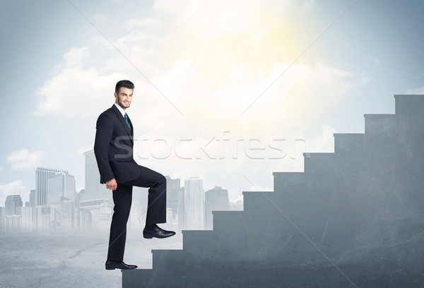 Businessman climbing up a concrete staircase concept Stock photo © ra2studio