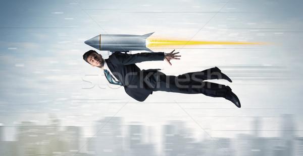 Geschäftsmann unter Jet Packung Rakete Stock foto © ra2studio