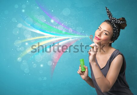 Beautiful girl blowing abstract colorful bubbles and lines Stock photo © ra2studio
