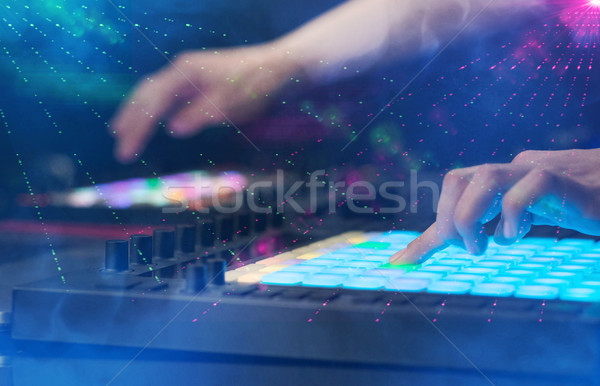 Hand mixing music on midi controller with party club colors around Stock photo © ra2studio