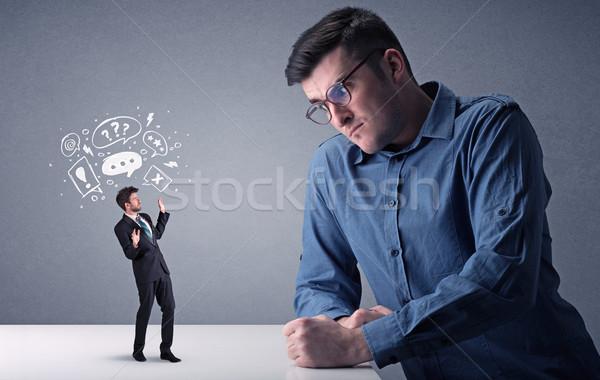 Jonge zakenman vechten miniatuur professionele boos Stockfoto © ra2studio