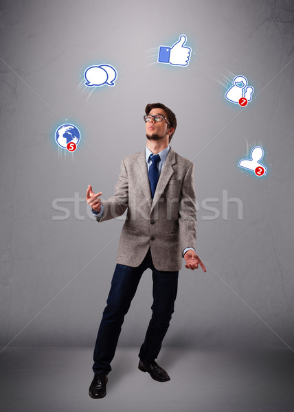 handsome young boy juggling with social media icons Stock photo © ra2studio