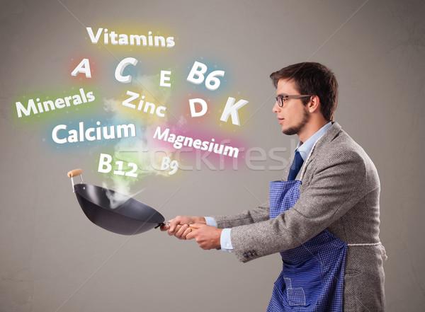 Man koken vitaminen mineralen knappe man voedsel Stockfoto © ra2studio