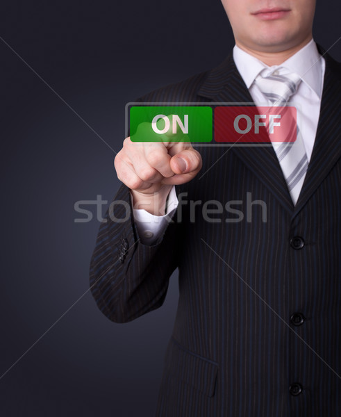 Man pressing ON / OFF button Stock photo © ra2studio