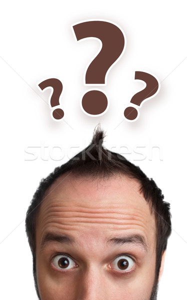 male adult has way too many questions in his head  Stock photo © ra2studio