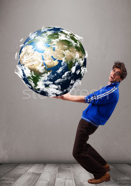 Good-looking man holding 3d planet earth Stock photo © ra2studio
