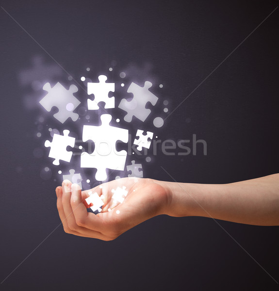 Puzzle pieces in the hand of a woman Stock photo © ra2studio