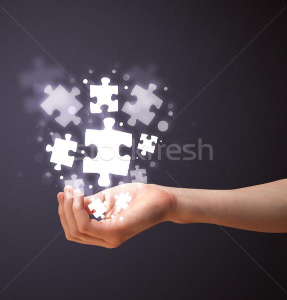Kirakó darabok kéz nő tart ragyogó üzlet Stock fotó © ra2studio