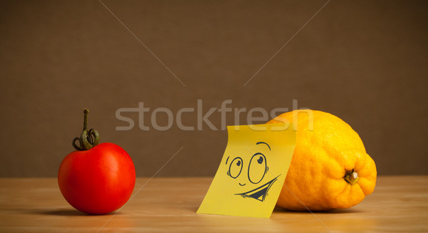 Lemon with post-it note looking curiously at tomato Stock photo © ra2studio