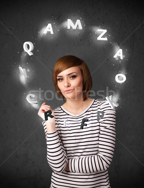 Young woman thinking with letter circulation around her head Stock photo © ra2studio