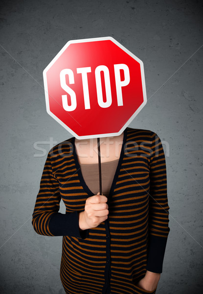 Young woman holding a stop sign Stock photo © ra2studio