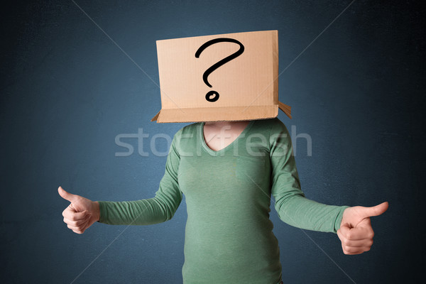 Young lady gesturing with a cardboard box on her head with quest Stock photo © ra2studio