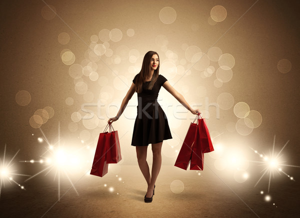 Shopping lady with bags in bright lights Stock photo © ra2studio