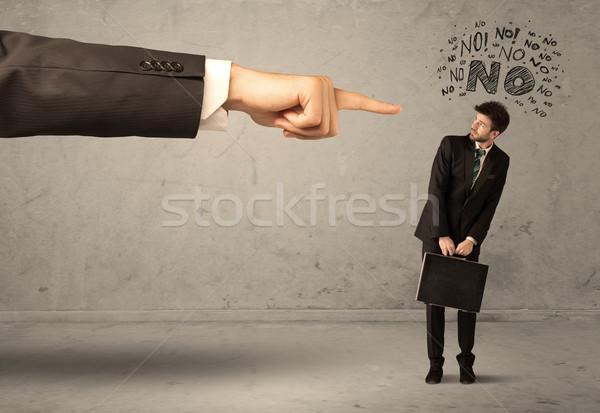 Boss hand guiding beginner salesman Stock photo © ra2studio