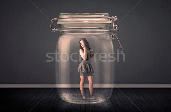 Kobieta interesu uwięzione szkła jar kobieta przestrzeni Zdjęcia stock © ra2studio