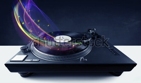 Turntable playing vinyl with glowing abstract lines Stock photo © ra2studio