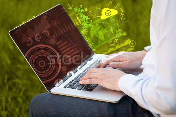 Stock photo: Modern notebook computer with future technology symbols