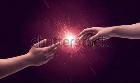 Tocante mãos luz para cima espaço Foto stock © ra2studio