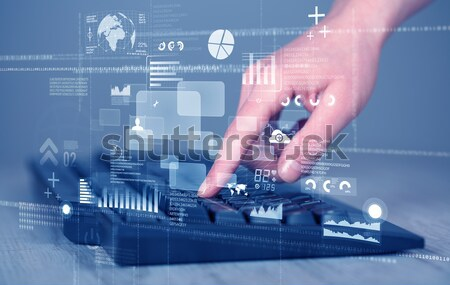 Keyboard buttons pressed by hand with high tech icons Stock photo © ra2studio