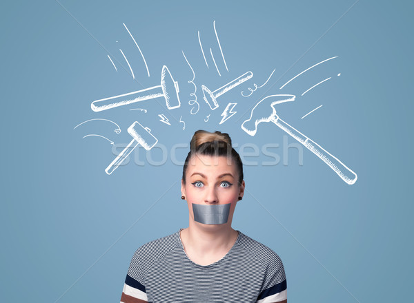 Young woman with glued mouth and hammer marks Stock photo © ra2studio