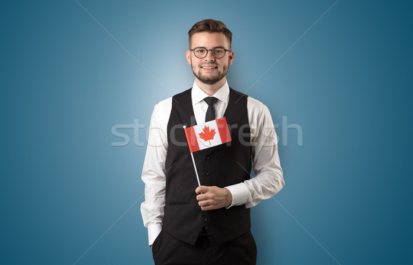 Handsome student standing with national flag Stock photo © ra2studio