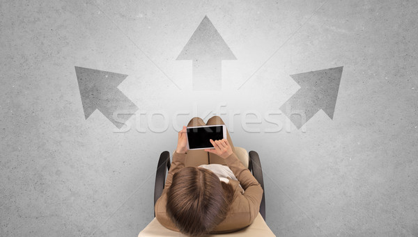 Woman sitting in office with device an her hand Stock photo © ra2studio