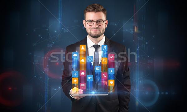 Homem comprimido holograma aplicativo ícones Foto stock © ra2studio