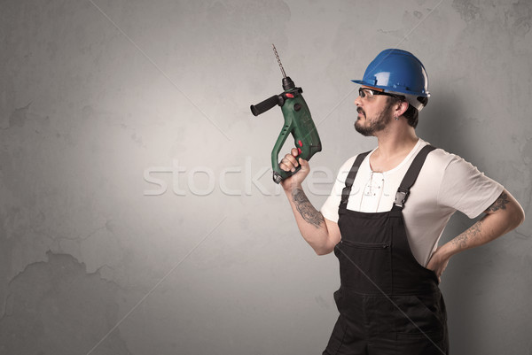 Craftsman standing in front of an empty wall. Stock photo © ra2studio